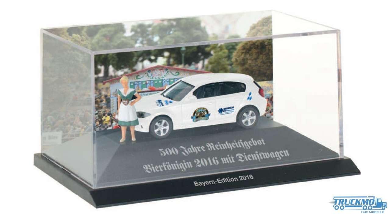 Herpa Bierkönigin / Bayernmodell 2016 BMW 1er mit Preisier Figur 926805