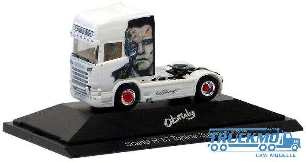 Herpa Obruly Arnold Schwarzenegger LKW Scania R '13 Topline Zugmaschine inkl. PC-Vitrine Modell